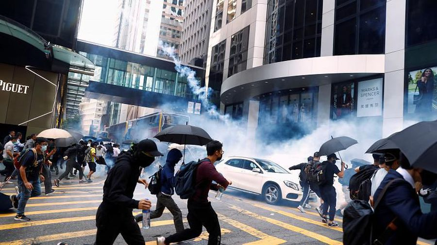 Hong Kong rocked by violent clashes as protester shot by police officer