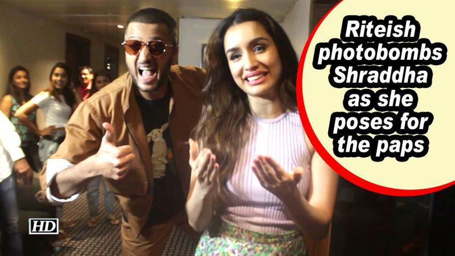 Riteish photobombs Shraddha as she poses for the paps