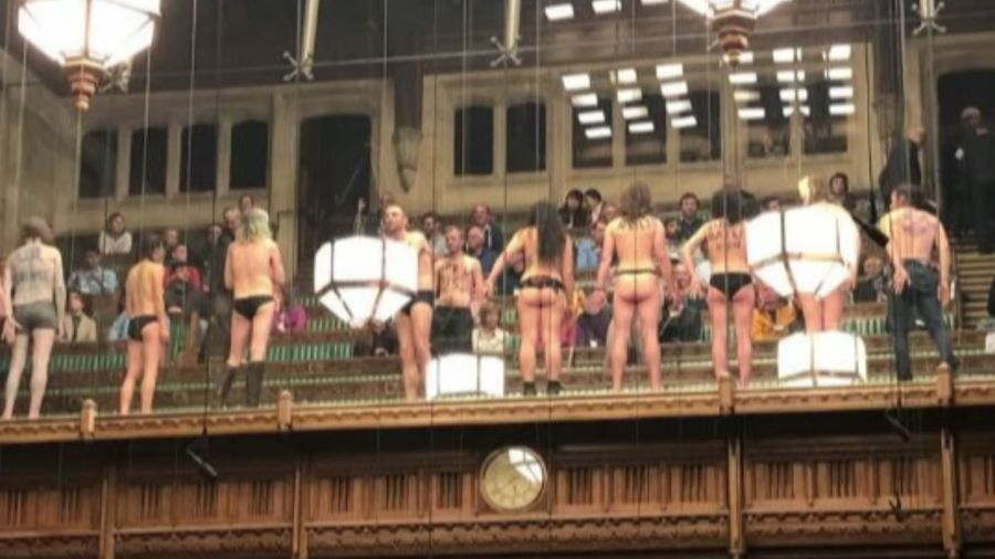 Climate change protesters strip off in Commons