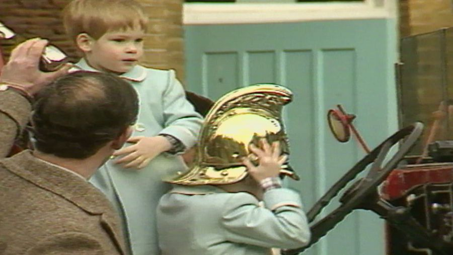 Royal Baby Countdown: Prince Harry plays on a fire engine