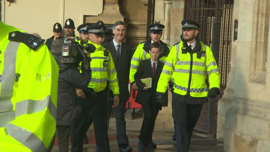 Gove and Rees-Mogg escorted by police through protests
