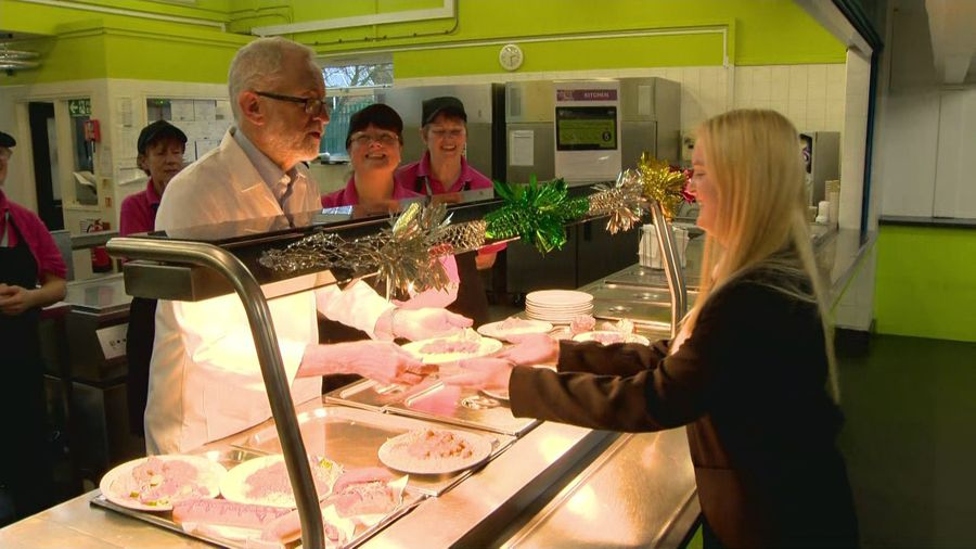 Jeremy Corbyn serves lunch to school pupils in Rugby