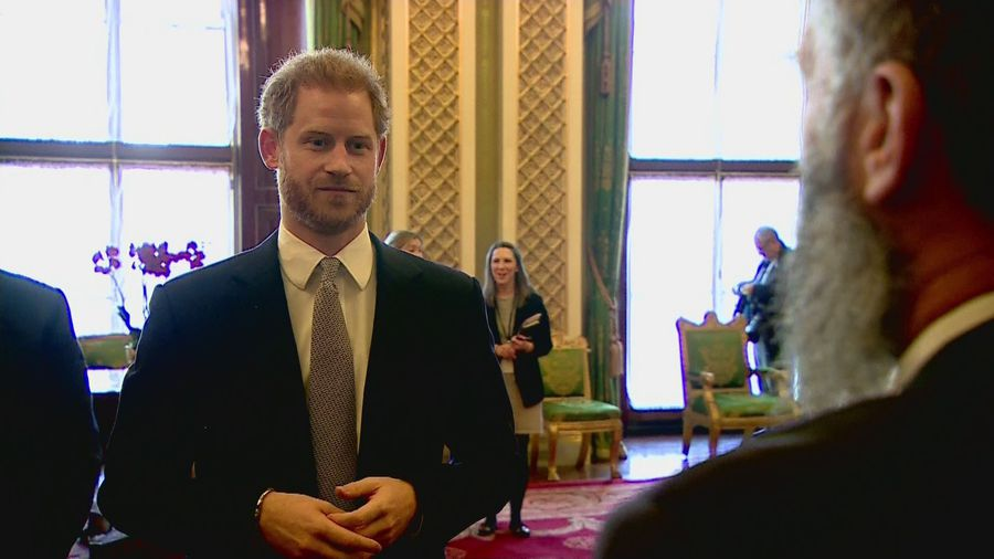 Prince Harry chats with Adam Hills before Rugby League draw