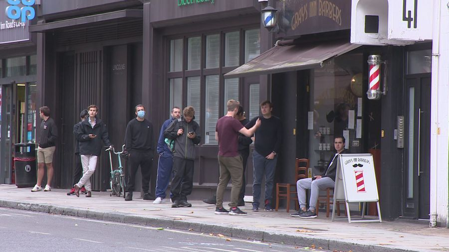 People queue for haircuts as lockdown is eased in England