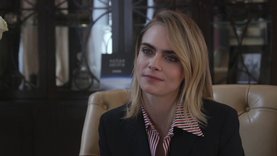Cara Delevingne says people must set aside differences to solve climate change
