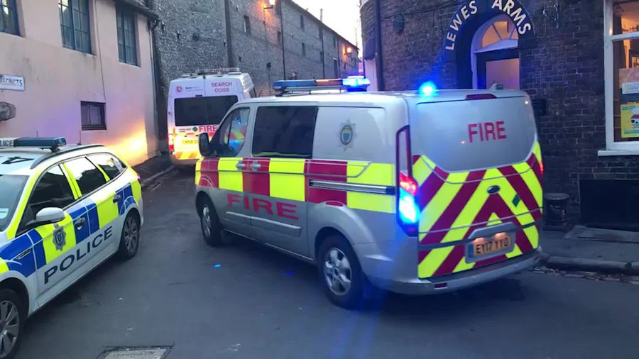 Emergency crews search rubble after medieval castle wall collapses