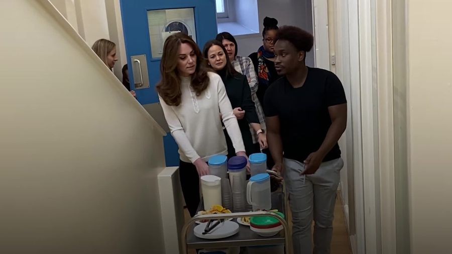 Kate serves breakfast to youngsters at social enterprise nursery