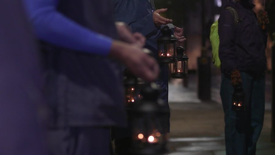 NHS staff and campaigners take part in candlelit vigil to remember lives lost