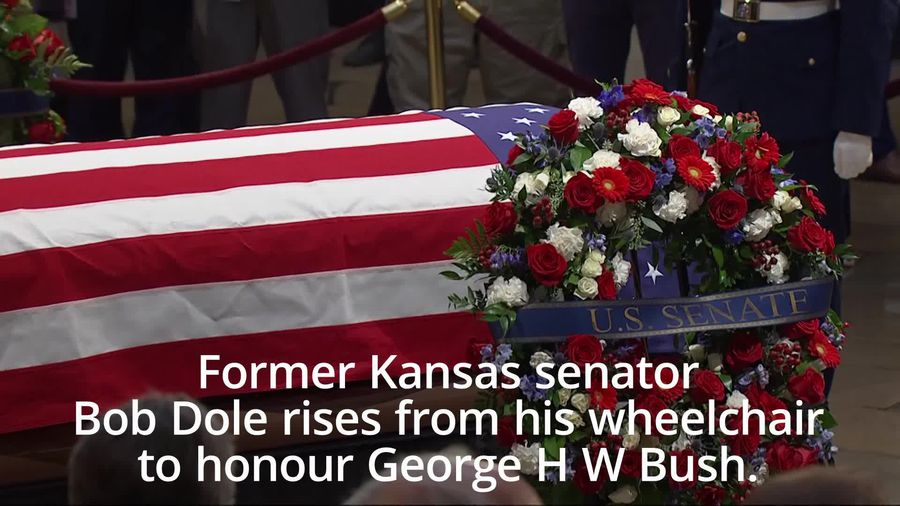 Bob Dole rises from wheelchair to salute George H W Bush