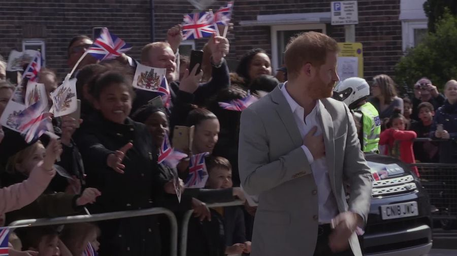 Prince Harry makes royal visit after private birth plans announced