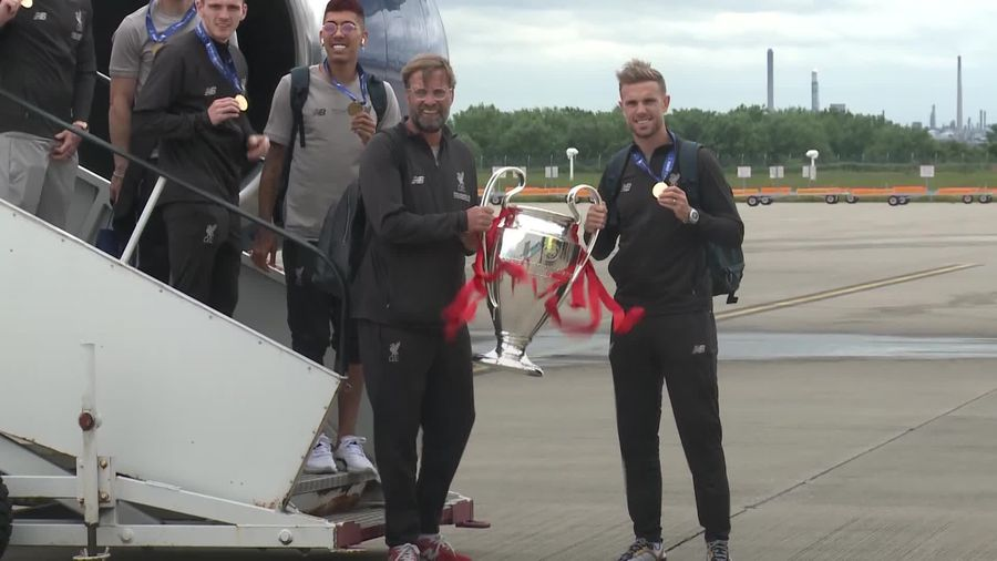 Champion League winners Liverpool arrive home