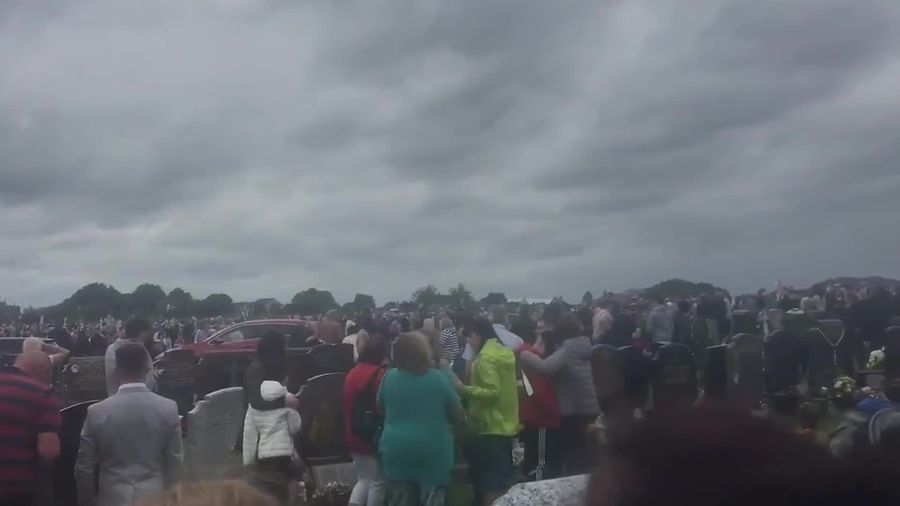 Pedestrian seriously injured as car collides with crowds at cemetery