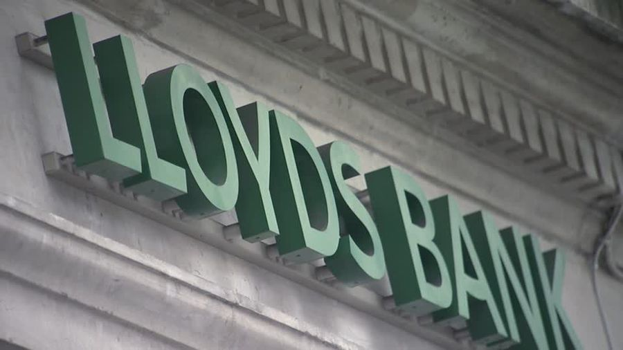 Britain's Lloyds hit by bad deeds and bad debts