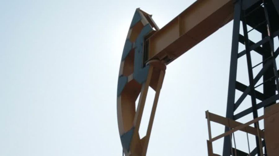 Oil prices slip towards 18-month lows ahead of New Year