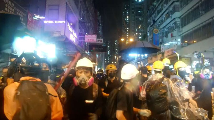 Hong Kong police fire live shots and water cannon