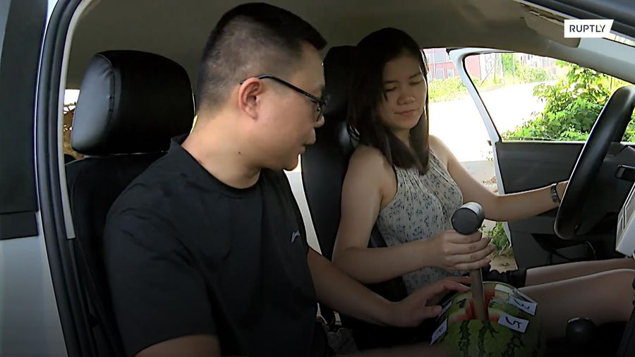 Chinese driving instructor's use of fruit goes viral