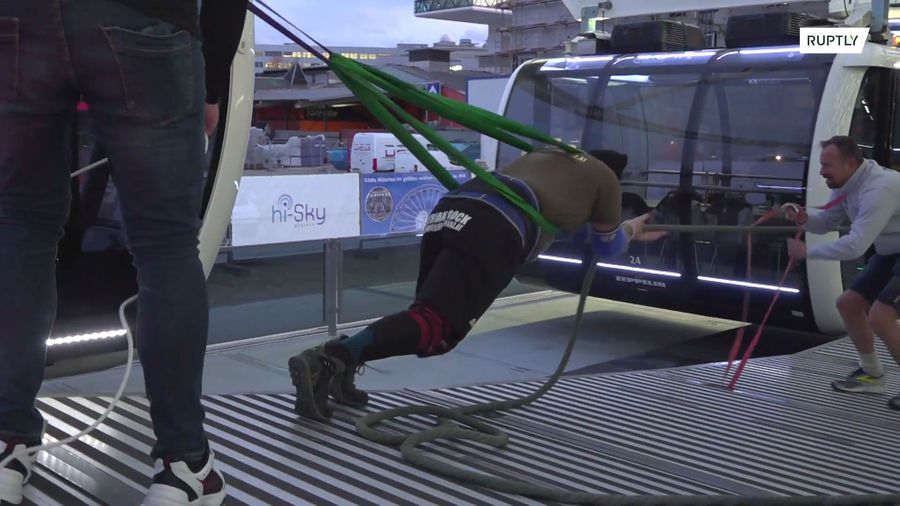Watch this Austrian strongman spin Munich's Ferris wheel with sheer strength
