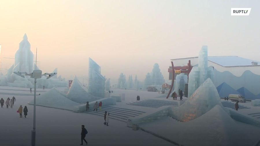 Otherworldly ice sculptures dazzle visitors at the world's largest ice festival