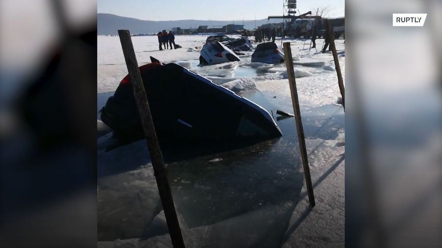 Cracking ride! Drivers scramble as 30 cars fall through ice on fishing trip