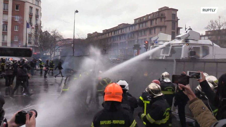 Violent clashes erupt between firefighters and police
