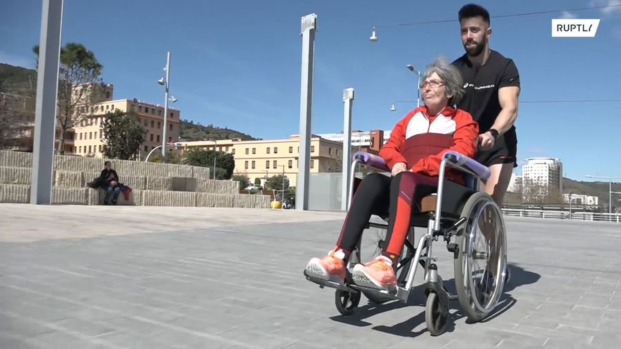 Best son in the world? Eric the marathon machine pushes mum with MS along in wheelchair
