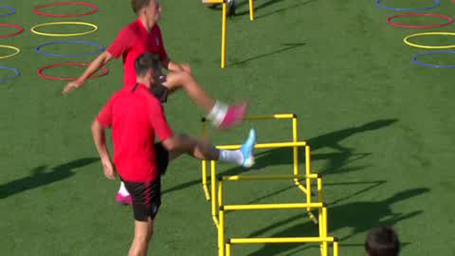 Felix and Trippier do the 'can-can' as they warm up for Atletico training