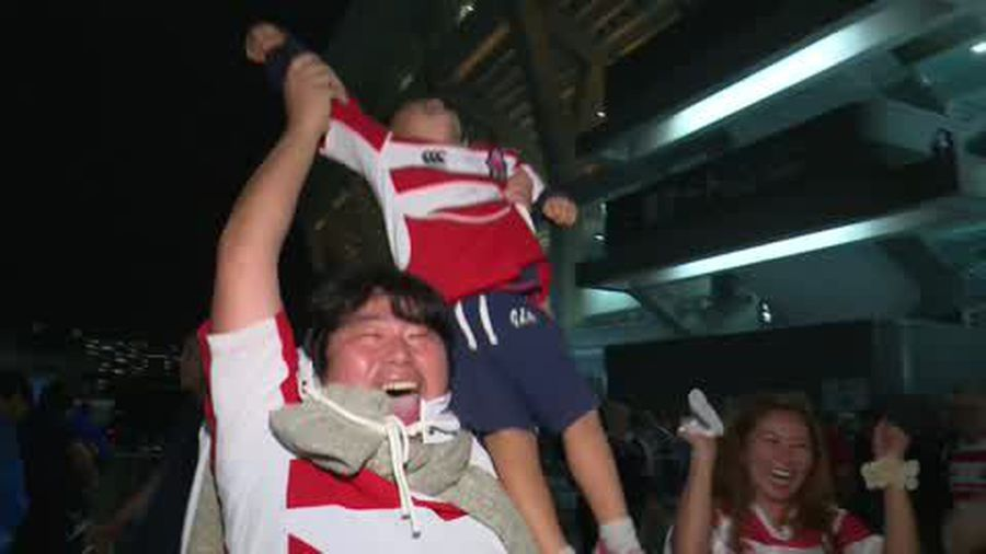 Japan fans cry with joy after reaching World Cup quarter-finals