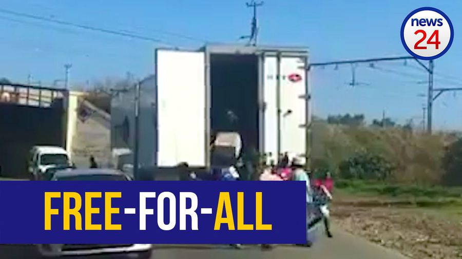 WATCH: Looters target truck trapped by too low bridge