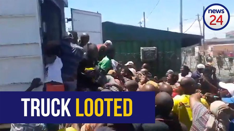 WATCH: Langa residents loot hijacked, abandoned truck