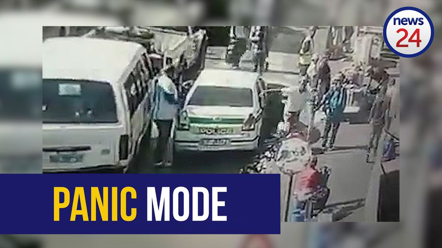 WATCH: Panicked Spaza shop owner flees from police vehicle