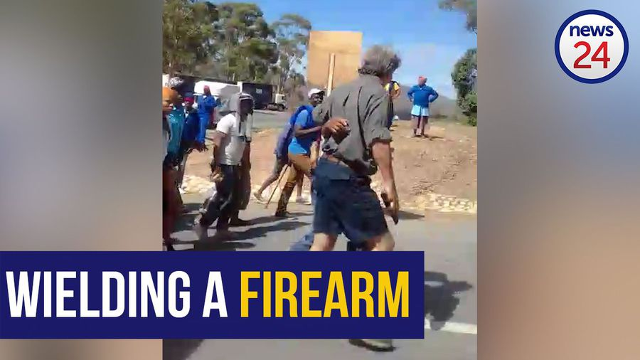 WATCH: Armed local farmer walks into demonstration in Greyton