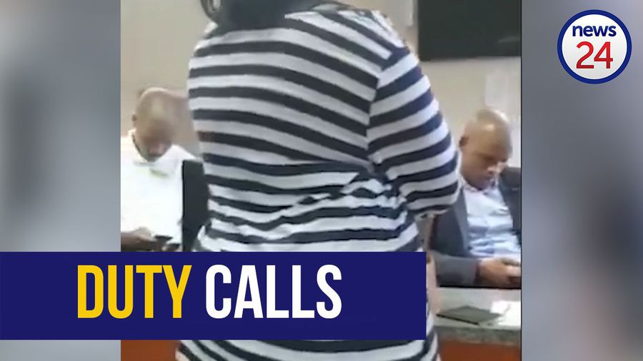 WATCH: Home affairs officials caught on their phones as people queue to be helped