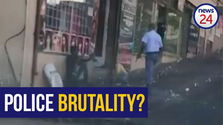 WATCH | Gun-toting Joburg cop caught on camera kicking two men