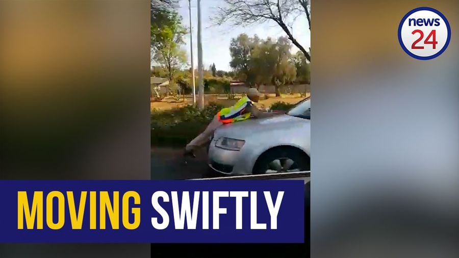 WATCH | Traffic cop goes the extra mile on moving vehicle's bonnet