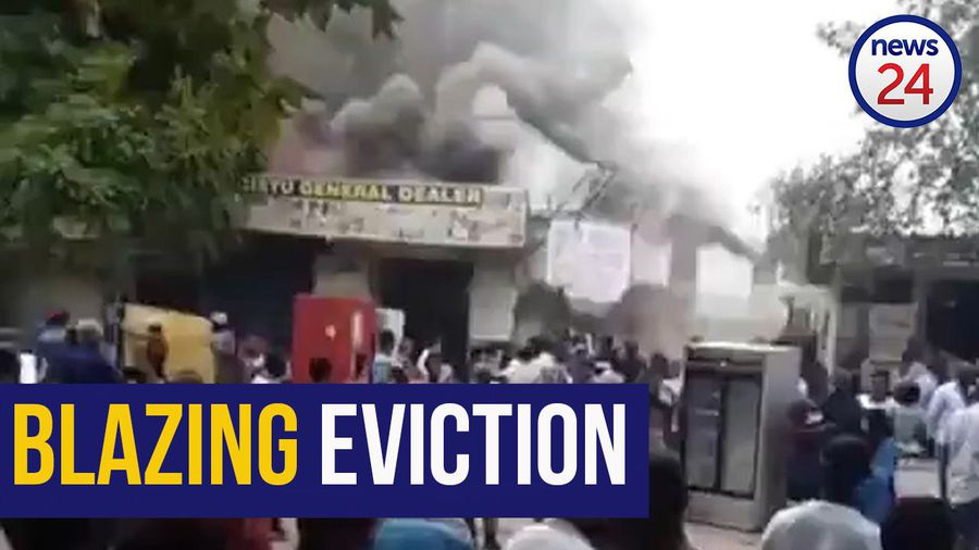 WATCH   Foreign nationals allegedly torch building after eviction