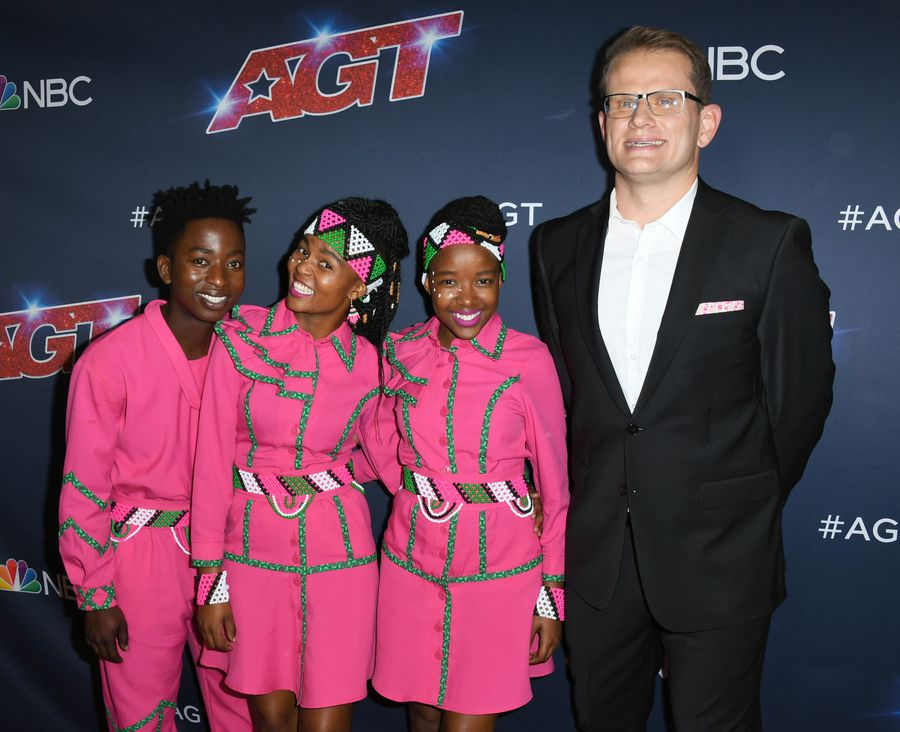 The Ndlovu Youth Choir tell us about meeting Simon Cowell and signing to his label