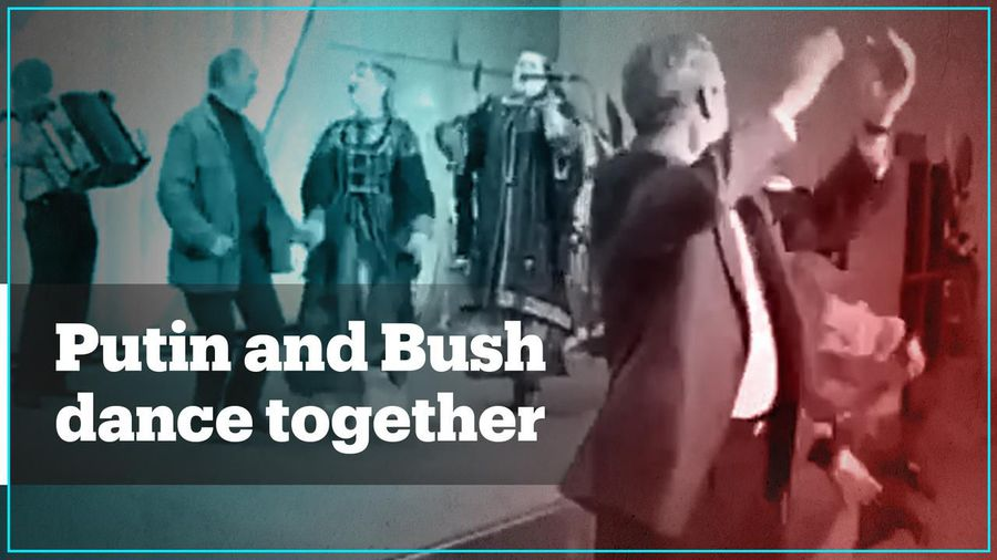 Archive footage shows Putin and Bush dancing together