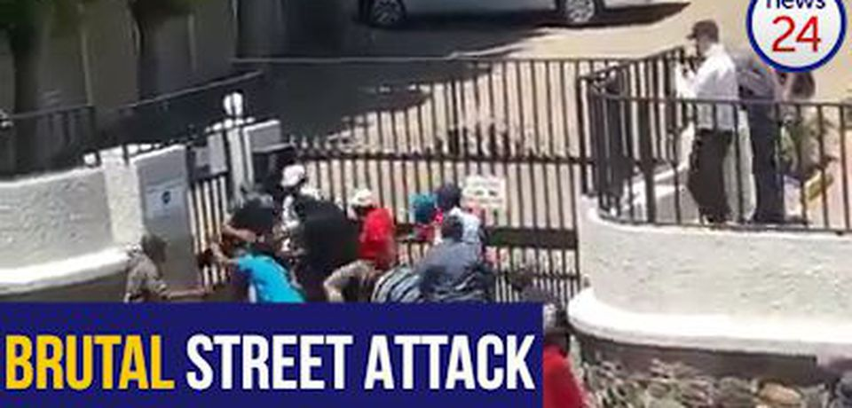 WATCH: Crowd brutally attacks man armed with paintball gun