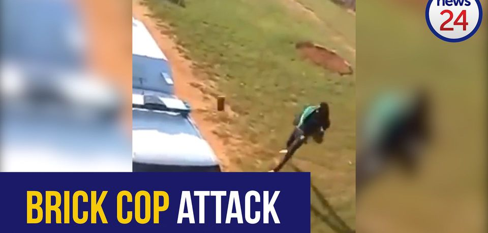WATCH: Brick slinging man attacks cops