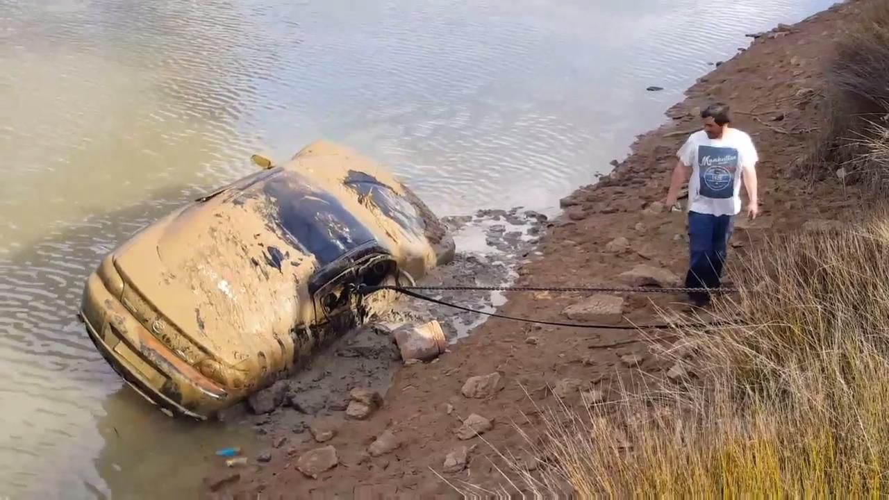 Police find car dumped in channel
