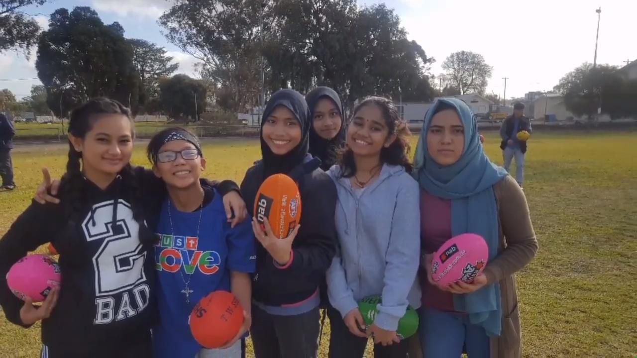 New migrants learn AFL